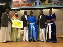 Commonwealth Short Story Winner (2014) Jennifer Makumbi (in light blue gomesi) presenting their ettoffaali