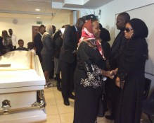 Uganda's High Commissioner to London Joyce Kikafunda consoles Sarah's daughter Daisy Kyolaba