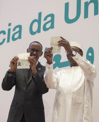 African Union Passports. Presidents Paul Kagame (left) and Idriss Deby (Chad) display their diplomatic AU passports at the 27th AU summit-Kigali